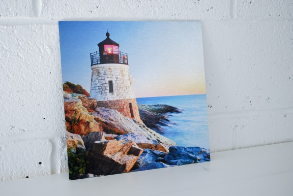 Lighthouse on Ocean Shore Photo Printed on Aluminum