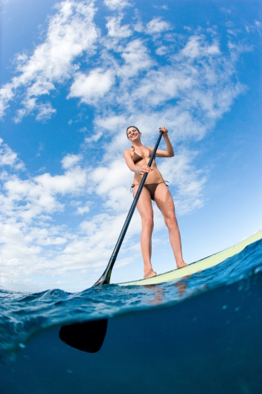 Woman on paddle board underwater photography