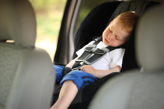 Toddler sleeping in vehicle in car seat