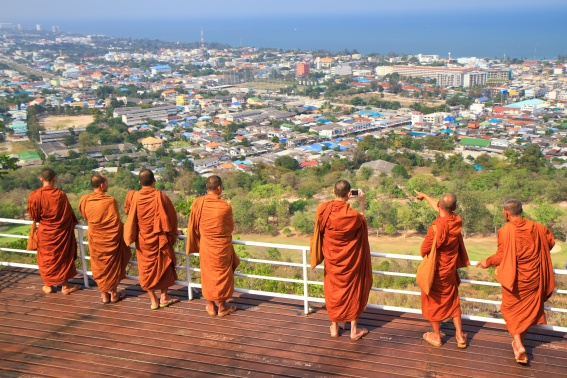 Group of monks standing on the view point of HuaHin mountain