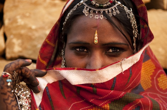Traditional Indian woman covering her face