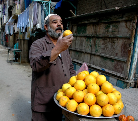 Man selling fruit in the street of Egypt village