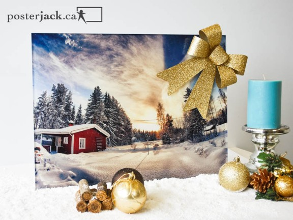 Posterjack Acrylic Print of house in the snow with Christmas decorations and candle