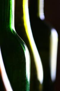 This close-up shot of coloured glass bottles illustrates the use of curved leading lines.