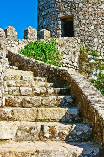 Old stone stairs leading up to a castle