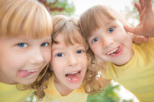 Close-Up of Three Children Making Silly Faces