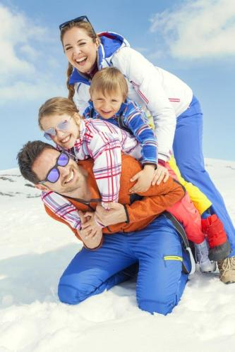 Winter Portrait of Family in Snow