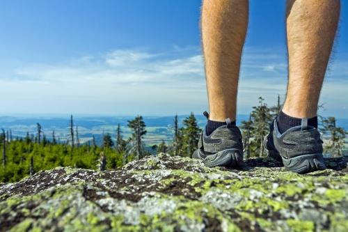 Landscape Photo of Hiker on a Rocky Summit