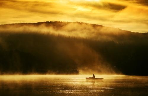 Early Morning Sunrise Landscape Boating on a Lake