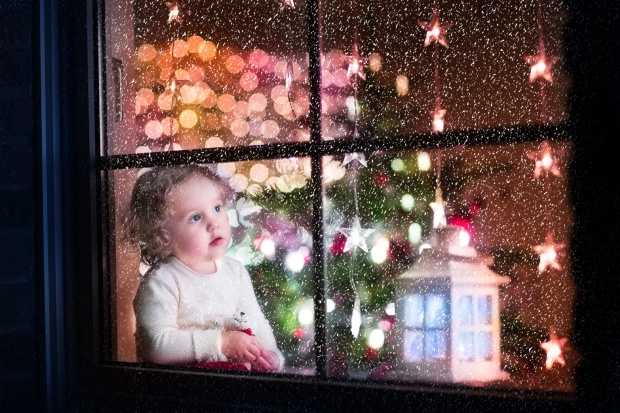 Toddler Looking Out Window at Snow on Christmas Eve