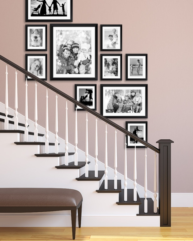 Photo gallery wall displayed in a staircase